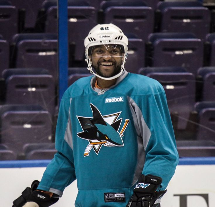 Joel Ward in San Jose Sharks uniform on ice.